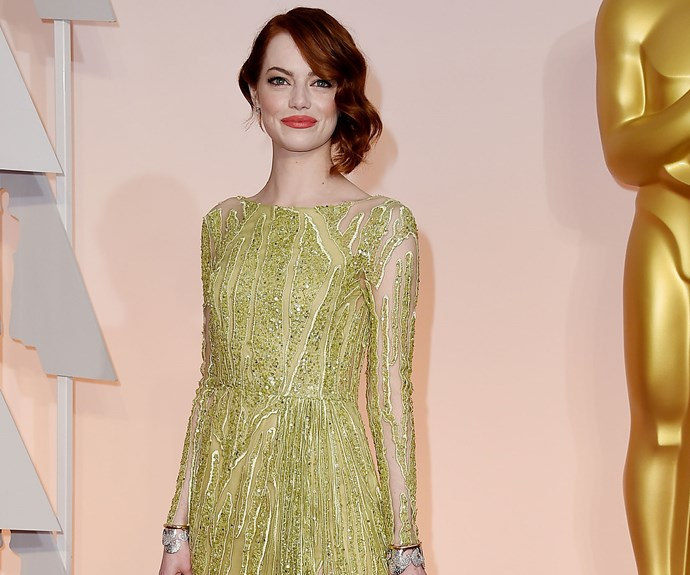 Emma Stone's coral lip contrasted with her shimmering chartreuse dress, and we love the nod to '20s style waves in her hair.