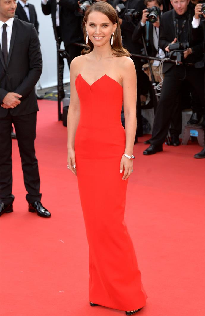 Natalie Portman looks red-hot in Christian Dior on day one of the Cannes Film Festival.